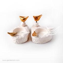 شمعدان سرامیکی سفید طلایی طرح 1 فرنگار محصولات