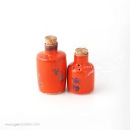 نمکدان و فلفل پاش نارنجی گل آبی ماه فروز محصولات